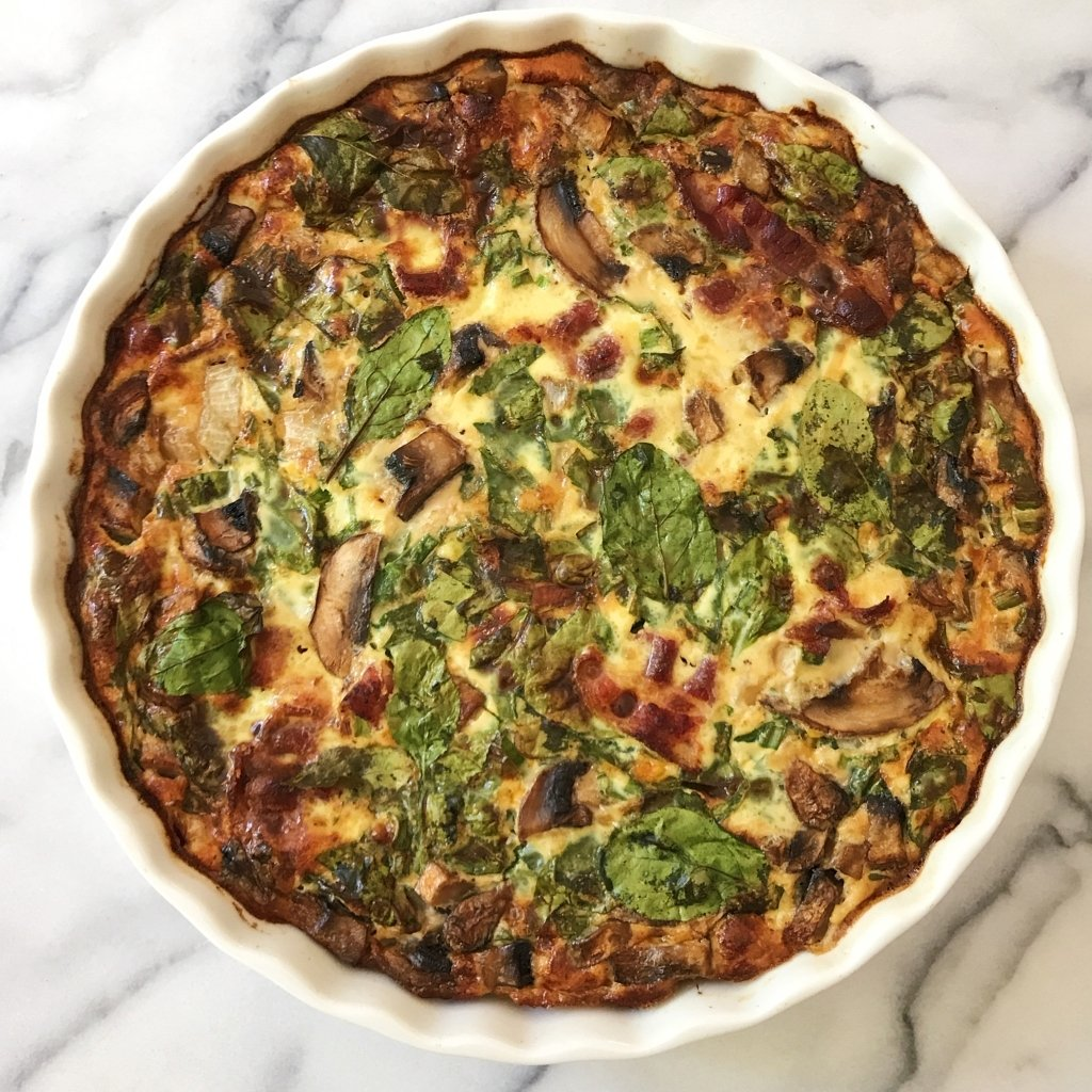 Gluten Free Spinach Mushroom Bacon Crustless Quiche. #glutenfree #grainfree #glutenfreerecipes www.healthygffamily.com