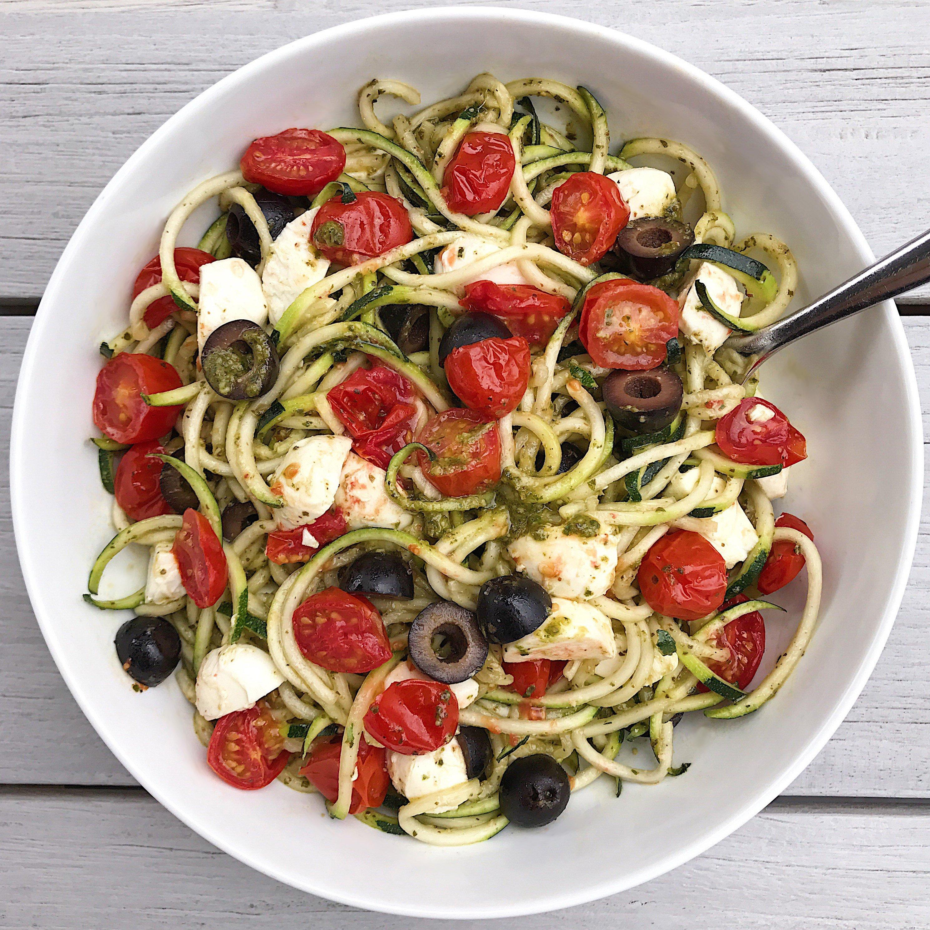 gluten free caprese zoodles with basil pesto #glutenfree #glutenfreerecipes #zucchinirecipes healthygffamily.com